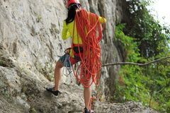 Rock climber standing with climbing gears Stock Photo