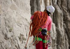 Rock climber standing in front of mountain cliff outdoor Royalty Free Stock Photos