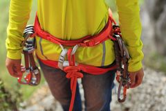 Rock climber standing with climbing gears Royalty Free Stock Photography