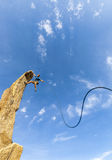 Rock climber struggles. Stock Image