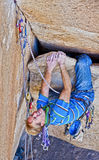 Rock climber struggles. Stock Photography