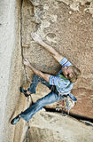 Rock climber struggles. Royalty Free Stock Photography