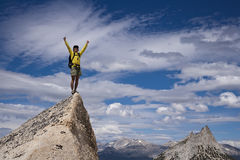 Rock climber on the summit. Royalty Free Stock Photos