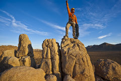Rock climber on the summit. Royalty Free Stock Photo