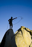 Rock climber on the summit. Royalty Free Stock Images