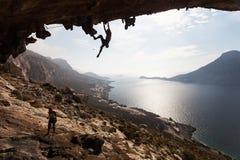 Rock climber at sunset Stock Images