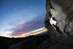 Rock Climber at sunset Stock Images