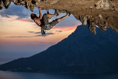 Rock climber at sunset Stock Image