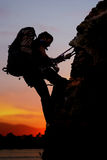 Rock climber at sunset Royalty Free Stock Images