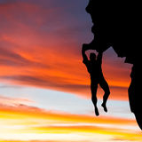 Rock climber with sunset Stock Photos