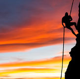Rock climber with sunset Royalty Free Stock Photography
