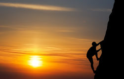Rock climber at sunset background. Royalty Free Stock Photography