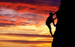 Rock climber at sunset background. Royalty Free Stock Image