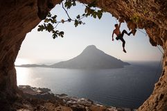 Rock climber at sunset Stock Photos