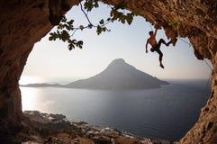 Rock climber at sunset Stock Photos