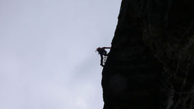 Rock climber in the Swiss Alps Stock Image