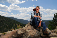 Rock climber on top of a mountain Stock Images