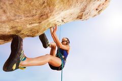 Rock climber training outdoors against blue sky Royalty Free Stock Images