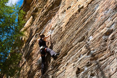 Rock climber on vertical sandstone. Rock climber ascending a sport route in Red River Gorge, Kentucky, on some wonderful sandstone Stock Photo