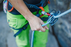 Rock climber wearing safety harness and climbing equipment outdoor Royalty Free Stock Photo