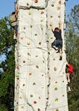 Rock Climbers. Young Boys Climbing A Rock Wall Stock Image