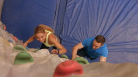 Rock climbers ascending the wall stock video