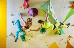 Rock climbers in climbing gym. Royalty Free Stock Image