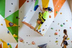 Rock climbers in climbing gym. Royalty Free Stock Photo