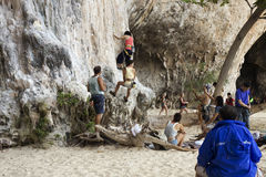 Rock climbers climbing the wall on Phra Nang beach Stock Image