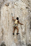 Rock climbers climbing the wall on Phra Nang beach Royalty Free Stock Photo
