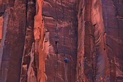 Rock Climbers on a very high rock wall royalty free stock photos