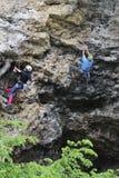 Rock climbers. Pair rock climbing on ridge Stock Photos