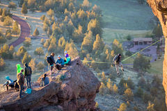 Rock Climbers At Smith Rock State Park. SMITH ROCK, OR - FEBRUARY 22, 2016: Highliner on a slackline that stretches between Smith Rock and Monkey Face at the Royalty Free Stock Images