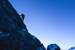 Rock climbers to summit. Adventure in pursuit of the snowy mountain peak.dangerous climbing without a rope Royalty Free Stock Photography