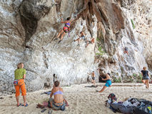 Rock climbers and tourists on Railay beach. Stock Image