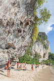 Rock climbers and tourists on Railay beach. Stock Photo