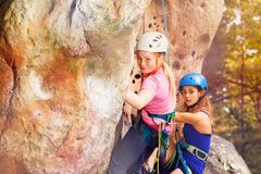 Rock climbers wearing helmets training outdoors Stock Photography