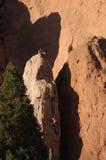Rock Climbing. Two rock climbers attempt to climb a rock cliff at Garden of the Gods, Colorado Stock Photo