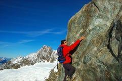 Rock-climbing. On Aiguille des Glaciers, Mont Blanc, Italy Stock Photo