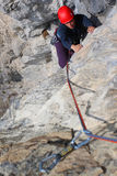 Rock climbing. Young woman climbing a limestone rock Royalty Free Stock Photography