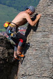 Rock climbing. Male rock-climber  on a granite wall Royalty Free Stock Photography