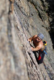 Rock climbing. Male rock-climber  on a granite wall Stock Photo