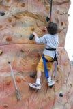 Rock climbing. Boy climbing rock out doors Royalty Free Stock Images