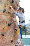 Rock climbing. Boy climbing rock out doors Stock Photo