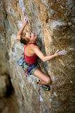 Rock Climbing. Female on a wild route stock photo