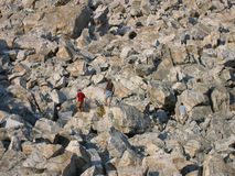 Rock climbing. Some guys climbing up a mountain of rocks Stock Images