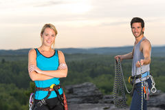 Rock climbing active people on top sunset Royalty Free Stock Images