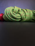 Rock climbing or arbotist rope on with text space. Close up of climbing rope coil on blake background Stock Image