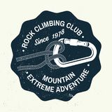 Vintage typography design with knot for quickly tying a climbing rope and carabiner. Rock Climbing club badge. Vector. Concept for shirt or logo, print, stamp Stock Photo