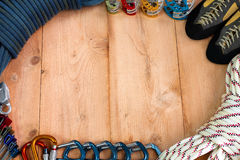 Rock Climbing Gear. Theme depicting a blue rock climbing dynamic rope, set of cams, climbing shoes, static rope, quickdraw carabiners, locking carabiners, set Royalty Free Stock Image